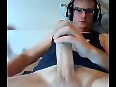 Canadian guy with a huge thick giant massive dick and glasses cums on cam