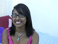 Horny Indian brunette with glasses lets you watch her play in bed