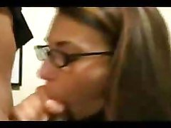 Brunette lass with glasses gives a blowjob