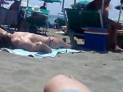 girl in topless in the beach