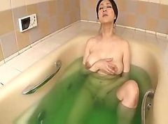 Busty Japanese girl takes a bath and then sucks his hard cock