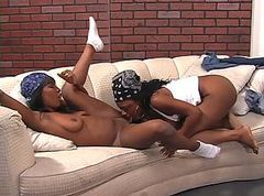 Horny black lesbians have group sex on couch