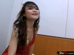 Brunette Thai tranny is fingering her ass and teasing dick