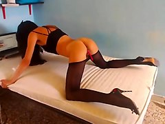 Cam girl in black pantyhose masturbates and squirts